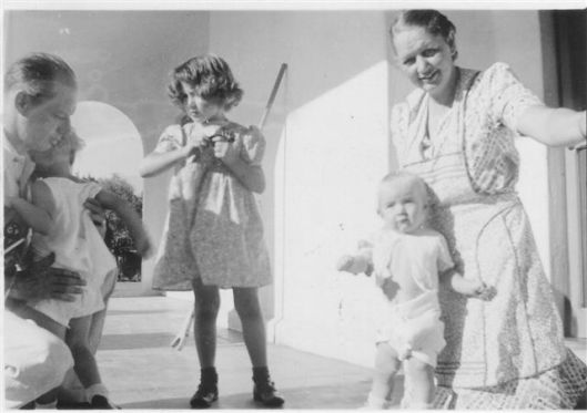 On the porch of my great-grandmother Catherine Decker Wilson's home in Monterrey. Left to right: Renie Wilson with his daughters Florence and Catherine.  Next to them is Cora Wilson Morris and her daughter.