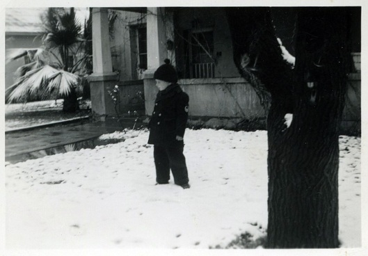 Flossy Wilson standing in front of Quinta #21 after snowfall